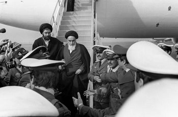 FILE PHOTO: Ayatollah Ruhollah Khomeini arrives in Tehran on February 1979 after returning from exile in France.