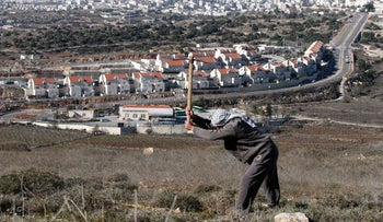 A picture taken from the West Bank city of Hebron on February 7, 2017 shows a view of the Kiryat Arba Jewish settlement on the outskirts of the Palestinian city.