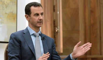 In this photo released by the Syrian official news agency SANA, Syrian President Bashar Assad speaks during an interview with Yahoo News in Damascus, Syria, Friday, Feb. 10, 2017.