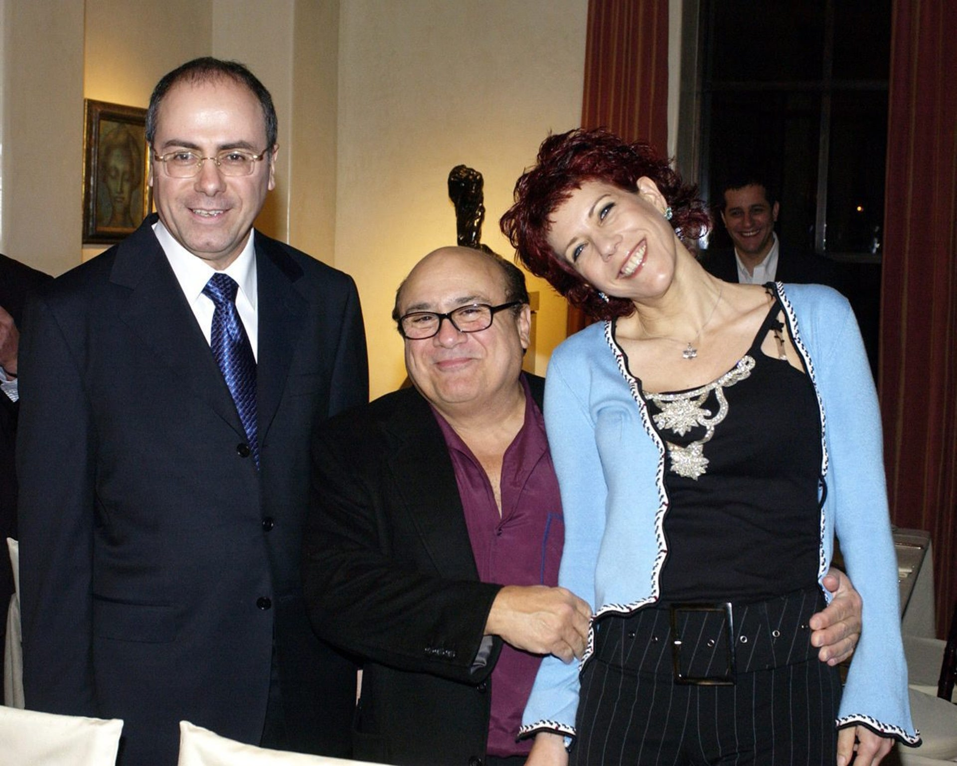 Silvan Shalom, his wife Judy Nir-Mozes-Shalom with Danny DeVito at a reception held at the Arnon Milchen's house.