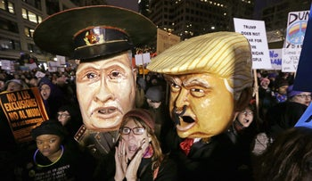 Effigies portraying Russia's President Vladimir Putin and U.S. President Donald Trump at rally against Trump's travel ban in Seattle, January 29, 2017.