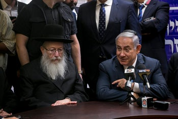 Prime Minister Benjamin Netanyahu and Health Minister Yaakov Litzman, at the opening of the Knesset winter session, October 23, 2017.