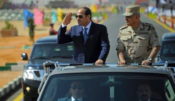 File photo from Oct. 29, 2017 shows Egyptian President Abdel-Fattah al-Sissi saluting as he inspects troops with Minister of Defense Sedki Sobhy, in the Red Sea port city of Suez, Egypt.