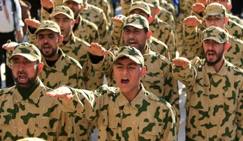 Hezbollah forces parade during a ceremony to honor fallen fighters, Tefahta village, south Lebanon, February 18, 2017.