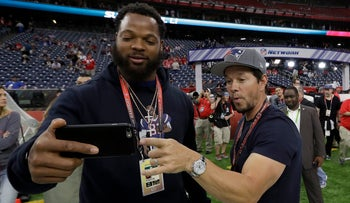 Seattle Seahawks' Michael Bennett (L) takes a selfie with actor Mark Wahlberg before the NFL Super Bowl game in in Houston, February 5, 2017.