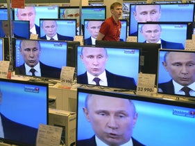 TV screens in a Moscow shop show a broadcast of President Vladimir Putin addressing the nation, April 17, 2014.