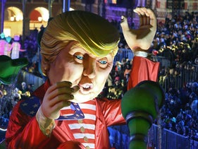 A huge U.S. President Donald Trump float parades during the Nice Carnival, Saturday, Feb. 11, 2017, in Nice, southeastern France.