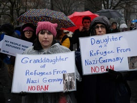 Protesters display placards during the Jewish Rally for Refugees at Battery Park in New York, February 12, 2017.