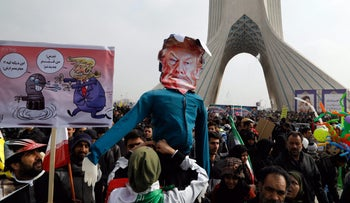 Iranians hold a dummy representing Trump at a rally in Tehran. Netanyahu will meet Trump on Wednesday