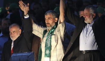 Freed Palestinian prisoner Palestinian Yahya Sanwar, a founder of Hamas' military wing, is greeted by Gaza's Hamas Prime Minister Ismail Haniyeh during a rally in Gaza City, Oct. 18, 2011.
