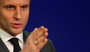 Emmanuel Macron, head of the political movement En Marche !, or Onwards !, and candidate for the 2017 presidential election, gestures as he talks to journalists about ecology at his campaign headquarters in Paris, France, February 9, 2017.
