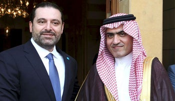 In this photo released on Oct. 28, 2016 by Lebanon's official government photographer Dalati Nohra, Lebanese Prime Minister Saad Hariri, left, shakes hands with Saudi Minister for Gulf Affairs Thamer al-Sabhan, right, in Beirut, Lebanon