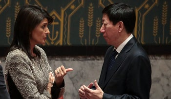 U.S. ambassador to the United Nations Nikki Haley talks with Wu Haitao, Chinese deputy ambassador to the UN, at the conclusion of an emergency meeting of the UN Security Council concerning North Korea's nuclear ambitions, November 29, 2017.