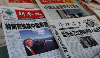 Chinese news papers showing U.S. President Donald J. Trump at a newsstand in Shanghai, China January 21, 2017.