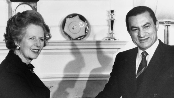 Britain's Prime Minister Margaret Thatcher greets Egypt's President Hosni Mubarak inside 10 Downing Street, London on March 14, 1985 where they had talks.