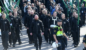 Members of the Nordic Resistance Movement march in central Goteborg, Sweden, Saturday Sept. 30, 2017.