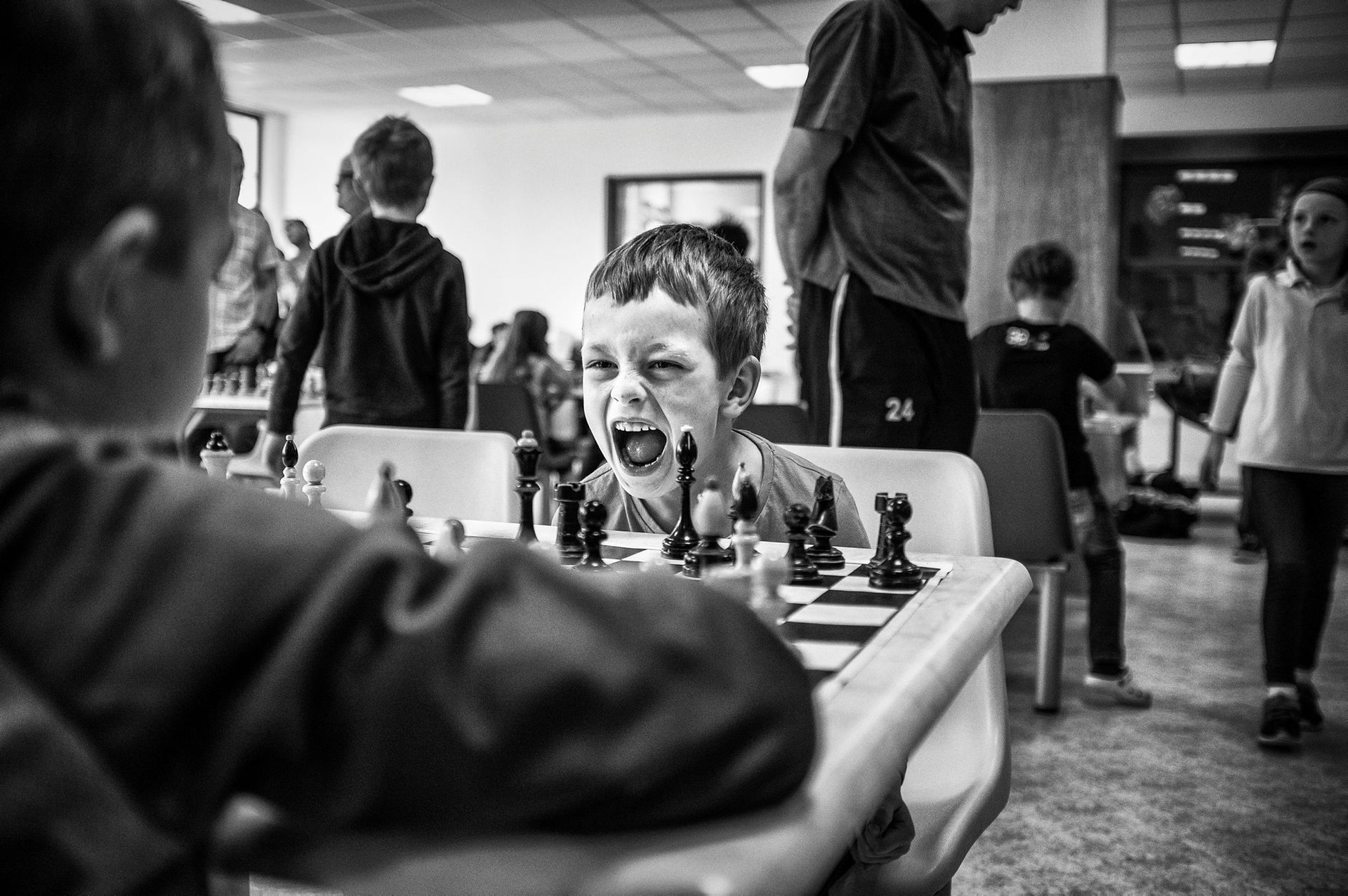 Sports, second prize stories - The chess player expresses his emotions during a game of chess.