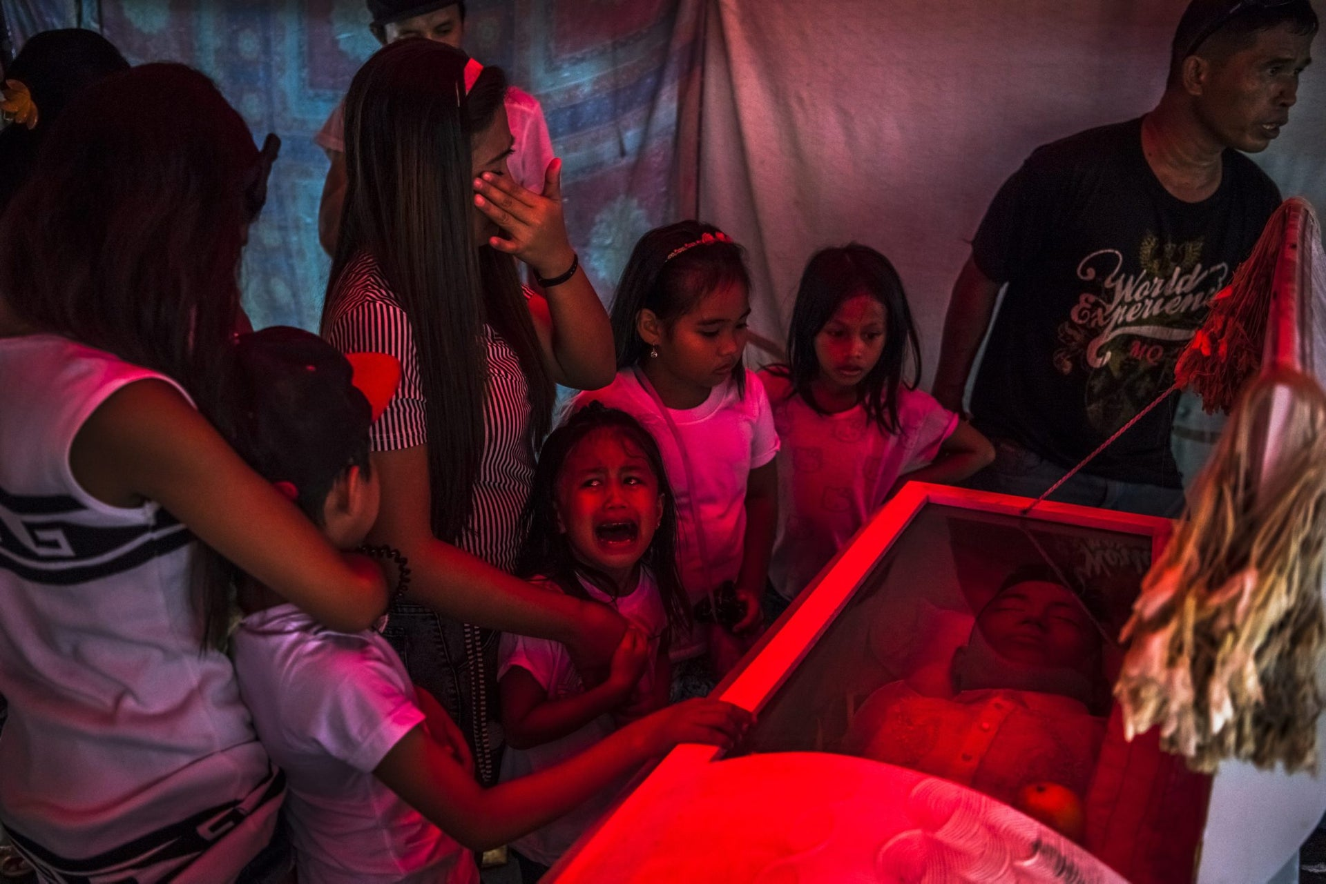 """General News, first prize stories - Six-year-old Jimji cries in anguish as she screams """"papa"""" before funeral parlor workers move the body of her father, Jimboy Bolasa, from the wake at the start of the funeral to Navotas Cemetery in Manila, Philippines. Unidentified men abducted Mr. Bolasa and a neighborhood friend one night. Less than an hour later, their beaten bodies, with signs of torture and gunshot wounds, were dumped under a nearby bridge."""