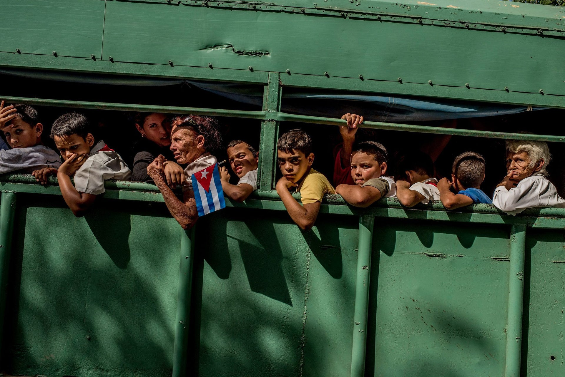 Daily Life, first prize stories - Trucks carried students home after the carriage carrying Fidel's ashes passed in Las Tunas Province, Cuba. Cuba declared nine days of mourning after Fidel Castro's death, a period that culminated with his funeral.