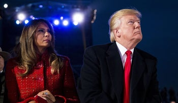U.S. President Donald Trump, right, and U.S. First Lady Melania Trump, sit during the 95th Annual National Christmas Tree Lighting in Washington, D.C., U.S., on Thursday, Nov. 30, 2017.