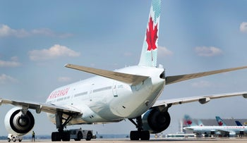 An Air Canada plane sits on the tarmac before takeoff in Toronto, Canada.
