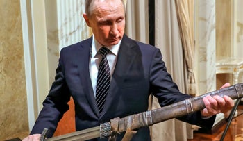 Russian President Vladimir Putin holds a sword on a film set on December 30, 2016.