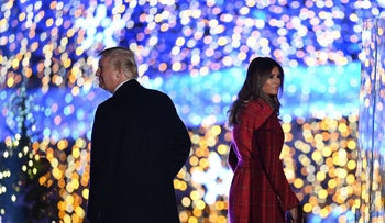 US President Donald Trump and First Lady Melania Trump walk on the stage during the 95th annual National Christmas Tree Lighting ceremony, Washington, DC on November 30, 2017.