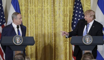 U.S. President Donald Trump (R) looks to Israeli Prime Minister Benjamin Netanyahu hold a joint news conference at the White House in Washington, U.S., February 15, 2017.
