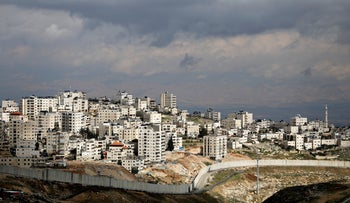 A general view shows the Israeli barrier running along the East Jerusalem refugee camp of Shuafat, in an area Israel annexed after capturing it in the 1967 Middle East war February 15, 2017