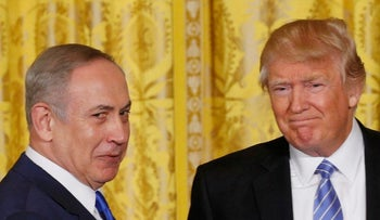 U.S. President Donald Trump (R) greets Israeli Prime Minister Benjamin Netanyahu after a joint news conference at the White House in Washington, U.S., February 15, 2017.