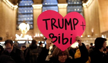 "A demonstrator holds a sign during a ""Muslim and Jewish Solidarity"" protest against the policies of U.S. President Donald Trump and Israeli Prime Minister Benjamin Netanyahu at Grand Central Terminal in New York City, U.S., February 15, 2017."