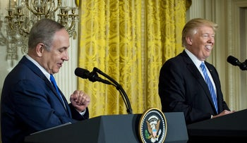 U.S. President Donald Trump, right, reacts while Benjamin Netanyahu, Israeli's prime minister, speaks during a news conference in the East Room of the White House, Feb. 15, 2017..