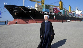 A handout picture provided by the office of Iranian President Hassan Rouhani on December 3, 2017 shows him (C) inauguraiting the first phase of Chabahar (Shahid Beheshti) Port in the southern Iranian coastal city of Chabahar.