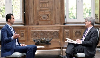 Syria's President Bashar al-Assad (L) speaks during an interview with Yahoo News in this handout picture provided by SANA on February 10, 2017