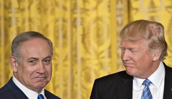 U.S. President Donald Trump looks at Israeli Prime Minister Benjamin Netanyahu during a news conference in the East Room of the White House in Washington, D.C., U.S., Feb. 15, 2017.