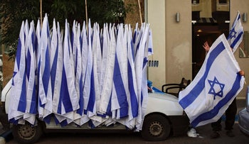File photo: An Israeli man sells Israeli flags ahead of Independence Day celebrations in Tel Aviv.