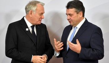 French FM Jean-Marc Ayrault, left, is welcomed by German counterpart Sigmar Gabriel prior to a meeting of the group of 20 foreign ministers in Bonn, February 16, 2017.