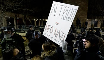 Protesters stand at the Mathematics building before the Milo Yiannopoulos speech at the University of Colorado campus in Boulder, Colo., Jan. 25, 2017.