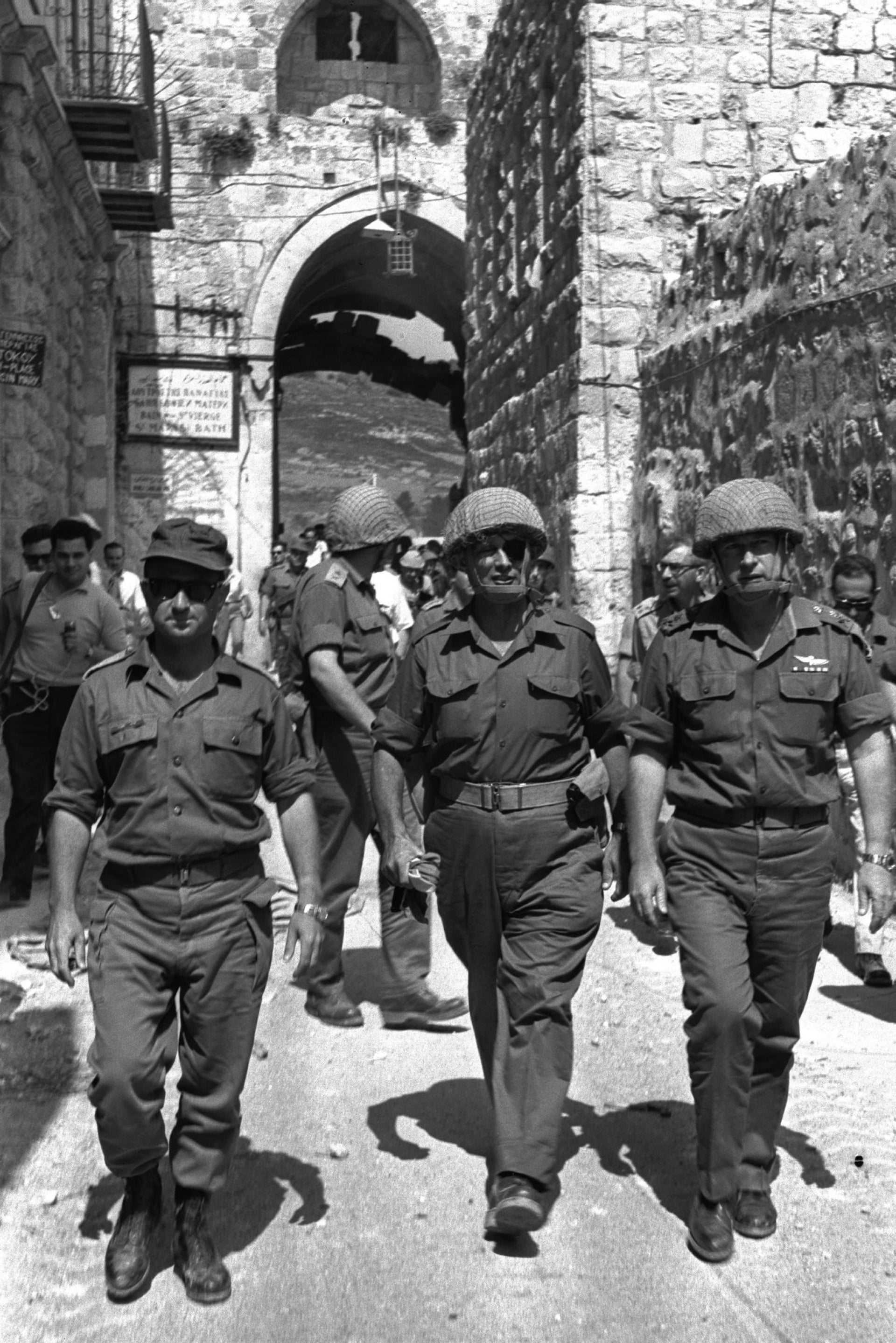 Defense Minister Moshe Dayan (c), Chief of Staff Yitzhak Rabin (r) and Jerusalem Commander Uzi Narkis walk through the Lion's Gate into the Old City, June 7, 1967.