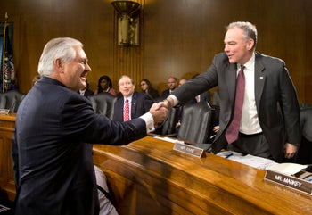 Senate Foreign Relations Committee member Sen. Tim Kaine D-Va., right, greets Secretary of State-designate Rex Tillerson on Capitol Hill in Washington, Wednesday, Jan. 11, 2017, prior to the start of Tillerson's confirmation hearing before the committee.