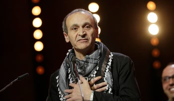 Director Raed Andoni speaks to the audience after winning the Original Documentary Award for 'Istiyad Ashbah (Ghost Hunting)' during the award ceremony at the 2017 Berlinale Film Festival in Berlin, Germany, Saturday, Feb. 18, 2017.
