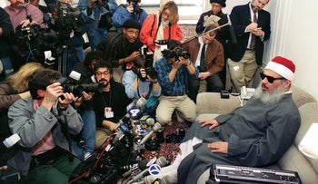 Sheikh Omar Abdel Rahman, the blind spiritual leader of Egypt's largest Islamic extremist fundamentalist group Jamaa Islamiyya facing photographers and reporters during a news conference in Jersey City.