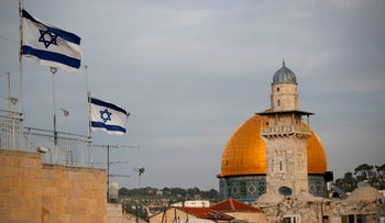 Israeli flags fly near the Dome of the Rock in Jerusalem, December 5, 2017.