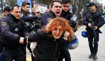 Riot police detain a demonstrator during a protest against the dismissal of academics from universities following a post-coup emergency decree, outside the Cebeci campus of Ankara University in Ankara, Turkey, February 10, 2017.