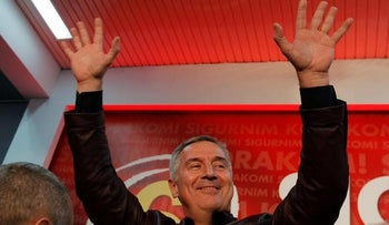 Montenegrin Prime Minister and leader of ruling Democratic Party of Socialist Milo Djukanovic waves to supporters after the parliamentary elections in Podgorica, Montenegro, October 17, 2016.