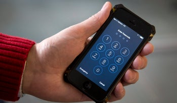 Watchdog groups that keep tabs on digital privacy rights are concerned that U.S. Customs and Border Patrol agents are searching phones, such as this iPhone pictured in February 2016, and other digital devices of international travelers at border checkpoints.