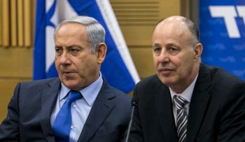 Benjamin Netanyahu and Tzachi Hanegbi at a meeting of Likud Knesset members.