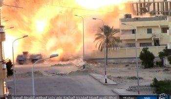 Photo published by ISIS shows an explosion as militants attack a police checkpoint in Sinai, Egypt, January 9, 2017.