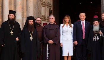 U.S. President Donald Trump and First Lady Melania Trump greeted by priests and others as they arrive for their visit at the Church of the Holy Sepulchre in the Old City of Jerusalem on May 22, 2017.