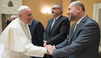 Pope Francis (L) shaking hands with Mahmoud Al-Habbash, Palestinian Minister of Religious Affairs, December 6, 2017 at the Vatican
